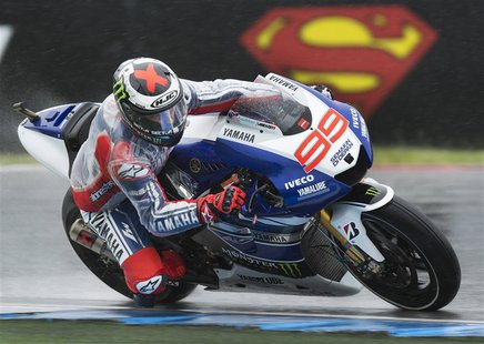 Yamaha MotoGP rider Jorge Lorenzo of Spain takes a curve during the free practice session of the Dutch Grand Prix in Assen June 27, 2013. RE