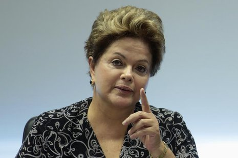 Brazil's President Dilma Rousseff gestures during a meeting with representatives from youth movement groups at the Planalto Palace June 28,