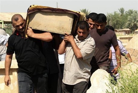 Relatives carry the coffin of a victim killed in one of two bomb attacks in Baquba, about 50 km (31miles) northeast of Baghdad, during a fun