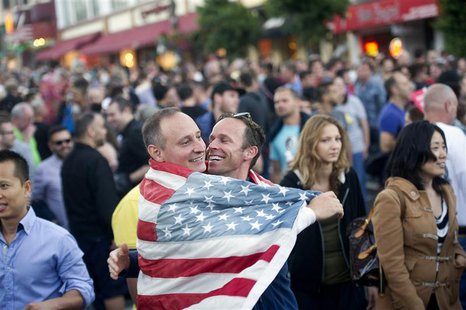 Ron Gerling (L) and Darrin Martin celebrate in San Francisco, California after the United States Supreme Court's ruled on California's Propo