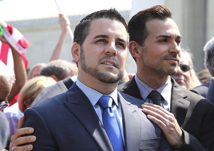 Jeff Zarrillo (L) and Paul Katami, plaintiffs in the case against California's gay marriage ban known as Prop 8, stand together in front of
