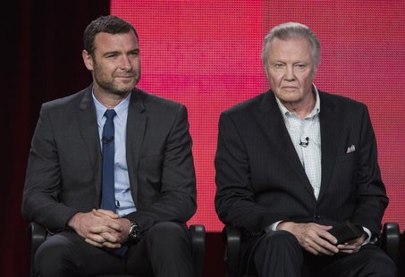 "Actors Liev Schreiber (L) and Jon Voight of the show ""Ray Donovan"" listen to a question on stage during the Showtime panel presentation of t"