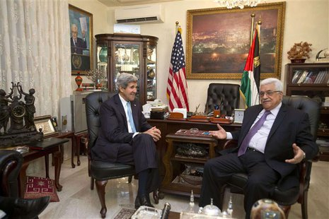 U.S. Secretary of State John Kerry (L) meets with Palestinian President Mahmoud Abbas in Amman, Jordan June 29, 2013. REUTERS/Jacquelyn Mart
