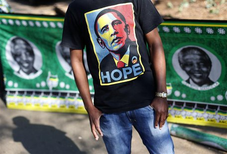 A man wears a t-shirt with a portrait of U.S. President Barack Obama outside the Medi-Clinic Heart Hospital where former South African Presi