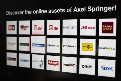 Logos of the digital products of the Axel Springer media group are presented before a news conference on annual results in Berlin March 6, 2