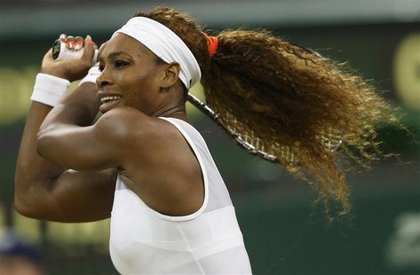 Serena Williams of the U.S. hits a return to Kimiko Date-Krumm of Japan in their women's singles tennis match at the Wimbledon Tennis Champi