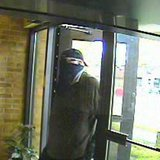 Security camera footage provided by the Calhoun County Sheriff's Office shows the suspect in the June 28, 2013 robbery of the Tekonsha branch of Southern Michigan Bank & Trust as he enters the bank.