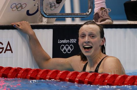 Winner Katie Ledecky of the U.S. celebrates after the women's 800m freestyle final during the London 2012 Olympic Games at the Aquatics Cent
