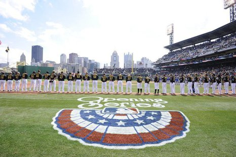 The Pittsburgh Pirates listen to the national anthem before playing against the Chicago Cubs in their opening day MLB National League baseba