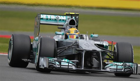 Mercedes Formula One driver Lewis Hamilton of Britain takes a curve during the qualifying session of the British Grand Prix at the Silversto
