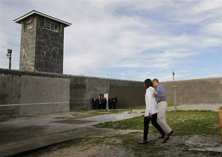 U.S. President Barack Obama tours Robben Island with first lady Michelle Obama, near Cape Town, June 30, 2013. REUTERS/Jason Reed