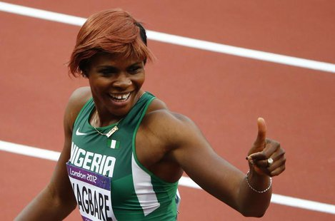 Nigeria's Blessing Okagbare gives the thumbs up sign after placing first in her women's 100m round 1 event at the London 2012 Olympic Games