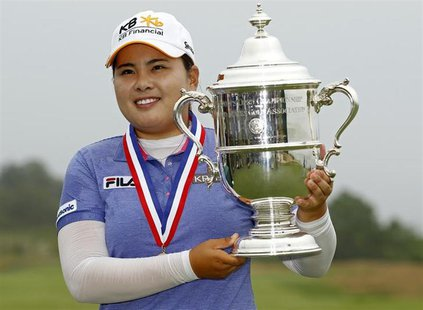 nbee Park of South Korea holds the 2013 Harton S. Semple Trophy after winning the 2013 U.S. Women's Open golf championship at the Sebonack G