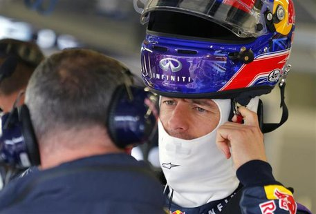 Red Bull Formula One driver Mark Webber of Australia prepares to set out on the first practice session ahead of the British Grand Prix at th