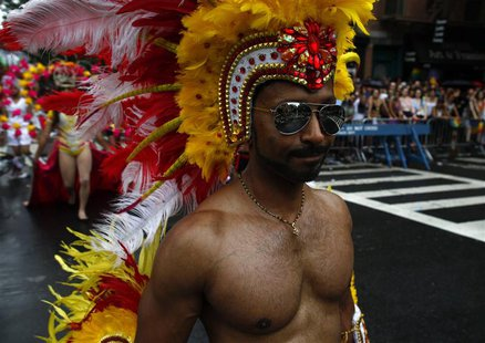 A man marches in the Gay Pride Parade in New York June 30, 2013. REUTERS/Eric Thayer