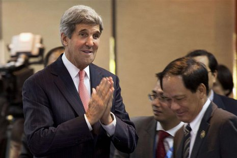 U.S. Secretary of State John Kerry gestures a greeting as he arrives to make opening remarks at the US-ASEAN Ministerial meeting, in Bandar