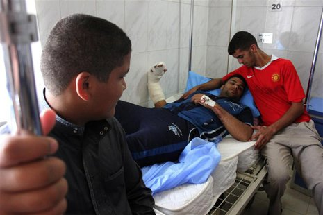 A man lies on a hospital bed after being wounded during one of two bomb attacks in the city of Baquba, about 50 km (31 miles) northeast of B