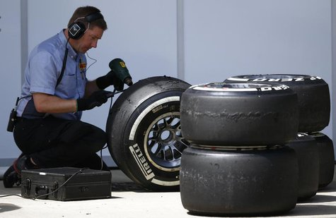A Pirelli technician works on a tyre during the British Grand Prix at the Silverstone Race circuit, central England, June 30, 2013. REUTERS/