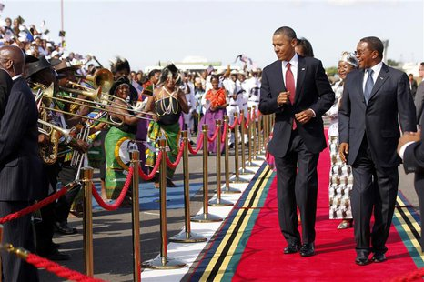 U.S. President Barack Obama dances as a Tanzanian band plays during an official arrival ceremony at Julius Nyerere Airport in Dar es Salaam,