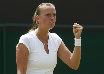 Petra Kvitova of the Czech Republic reacts after winning the first set during her women's singles tennis match against Carla Suarez Navarro