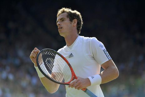 Andy Murray of Britain reacts in his men's singles tennis match against Mikhail Youzhny of Russia at the Wimbledon Tennis Championships, in