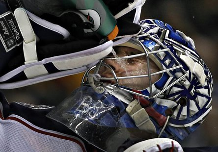 Columbus Blue Jackets goalie Sergei Bobrovsky squirts water on his face during a break in the play of their NHL hockey game against the Vanc