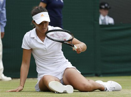 Laura Robson of Britain slips during her women's singles tennis match against Kaia Kanepi of Estonia at the Wimbledon Tennis Championships,
