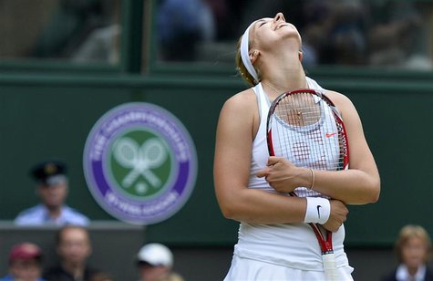 Sabine Lisicki of Germany reacts during her women's singles tennis match against Serena Williams of the U.S. at the Wimbledon Tennis Champio