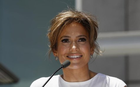 Singer and actress Jennifer Lopez speaks before unveiling her star on the Walk of Fame in Hollywood, California June 20, 2013. REUTERS/Mario