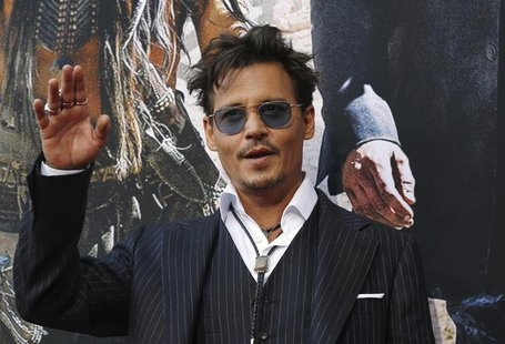 "Cast member Johnny Depp waves at the world premiere of ""The Lone Ranger"" at Disney California Adventure Park in Anaheim, California June 22,"