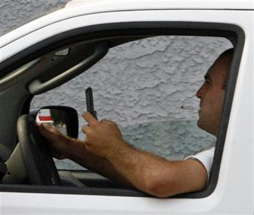 A new law making it illegal for young drivers to use a cell phone while driving takes effect Today (July 1), South Dakota Department of Public Safety officials remind citizens.  (Reuters Image)
