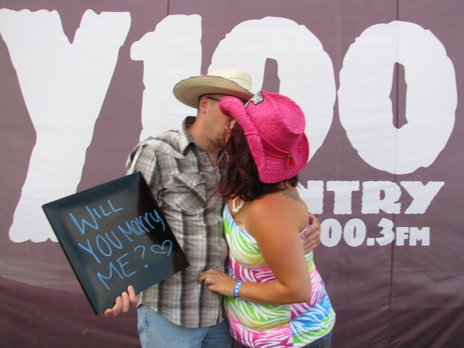 "He asked her to marry him in our ""Show Us Your Smiles"" photo booth with Northstar Dental. She said yes, then this happened..."