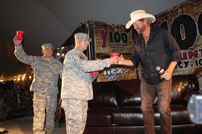 Toby toasts with troops in the Y100 Country Club!