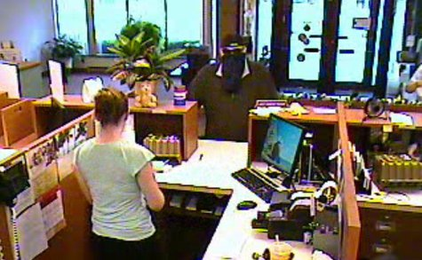 Security camera footage provided by the Calhoun County Sheriff's Office shows the suspect in the June 28, 2013 robbery of the Tekonsha branch of Southern Michigan Bank & Trust.