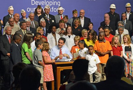 Governor Scott Walker at the 2013 state budget signing ceremony. (Photo: Wisconsin Radio Network)