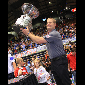 Storm head Coach Kurtiss Riggs raises the championship trophy after the Storm defeated Nebraska 43-40 Saturday night. Photo Courtesy of tslat.com.