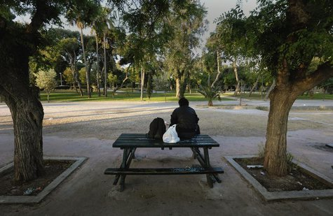 Giorgos, a 58-year-old who became homeless five years ago when he lost his job, sits on a park bench in Athens May 2, 2013. REUTERS/Yannis B