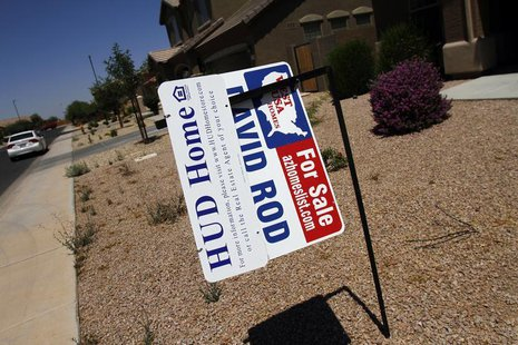 Real estate for sale and Housing and Urban Development (HUD) signs are displayed outside a home in Chandler Heights, Arizona June 2, 2011. R