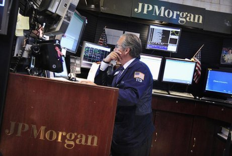 A trader works at the JP Morgan trading post on the floor of the New York Stock Exchange in New York July 13, 2012. REUTERS/Shannon Stapleto