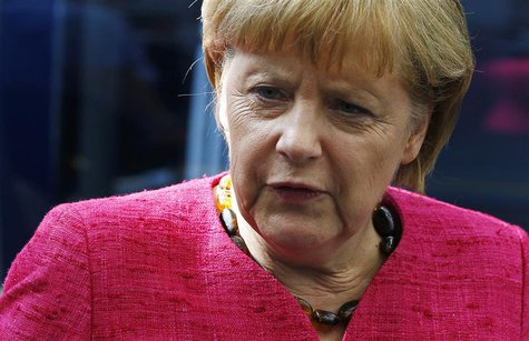 German Chancellor Angela Merkel frowns during a visit to technology company Trumpf in Ditzingen, near Stuttgart July 2, 2013. REUTERS/Michae