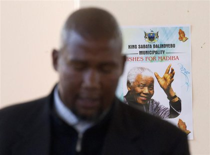 Mandla Mandela, grandson of former South African President Nelson Mandela, sings in front of a poster of his grandfather during a church ser