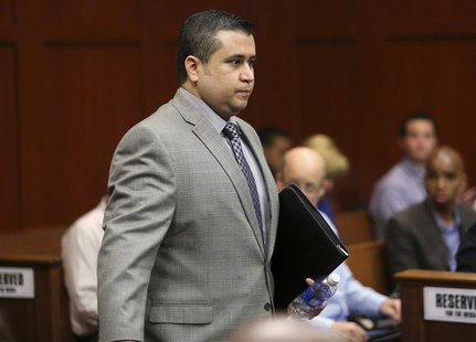 George Zimmerman enters the courtroom during his second-degree murder trial in Seminole circuit court in Sanford, Florida, July 2, 2013. REU