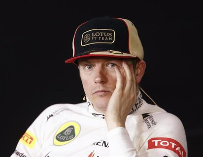 Second-placed Lotus Formula One driver Kimi Raikkonen of Finland attends a post-race news conference after the Chinese F1 Grand Prix at the