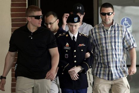 U.S. Army Private First Class Bradley Manning (C) is escorted from the courtroom after a day of his court martial trial at Fort Meade, Maryl