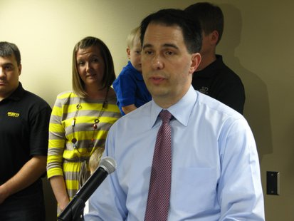 Walker addresses reporters at NTC.