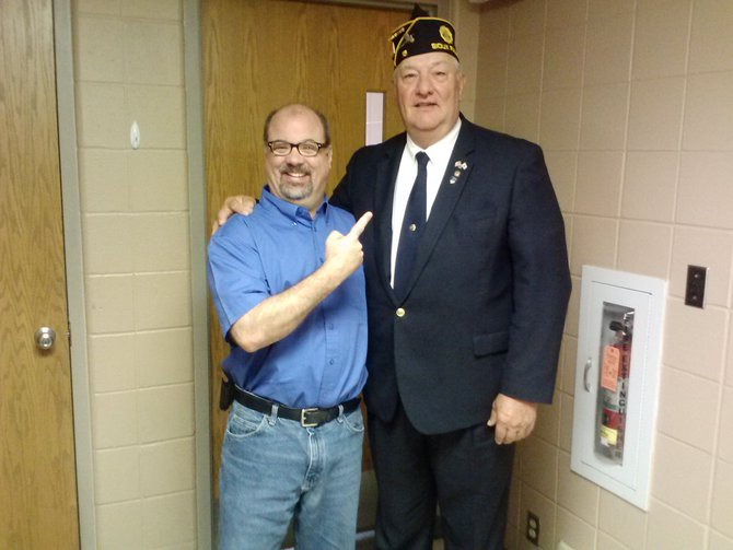 The commander of the Sioux Falls American Legion, Ken Teunissen, made me feel like a dwarf!  Brownie and I had great fun with Ken.  We discussed flag etiquette and care of Old Glory.  7/3/13