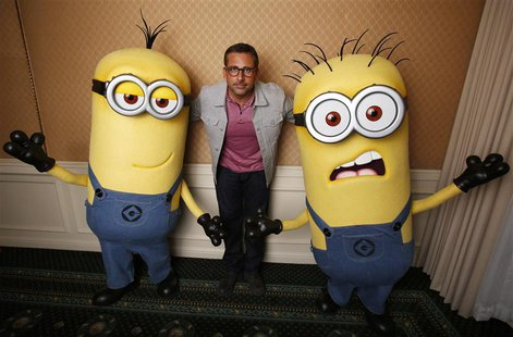 "Actor Steve Carell poses with two life-size minion characters while promoting his upcoming movie ""Despicable Me 2"" in Los Angeles, Californi"
