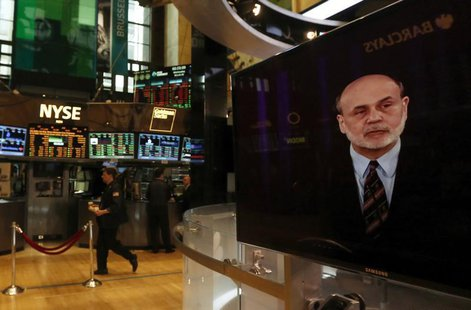 A press conference by Federal Reserve Chairman Ben Bernanke is seen on a television on the floor of the New York Stock Exchange, March 20, 2