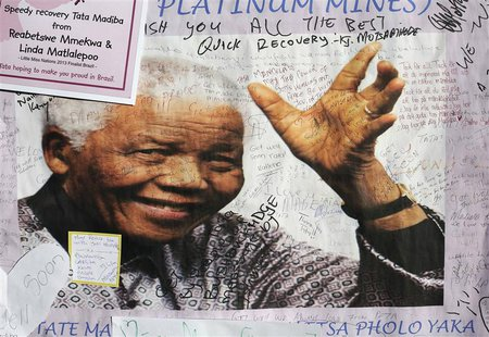 A poster of former South African President Nelson Mandela is filled with get well messages outside the Medi-Clinic Heart Hospital, where he