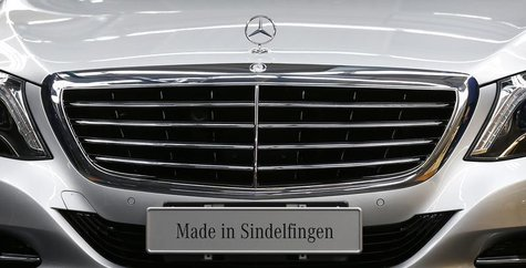 The emblem of German car Mercedes-Benz is pictured before a news conference about the new production line of the Mercedes-Benz S-class in Si